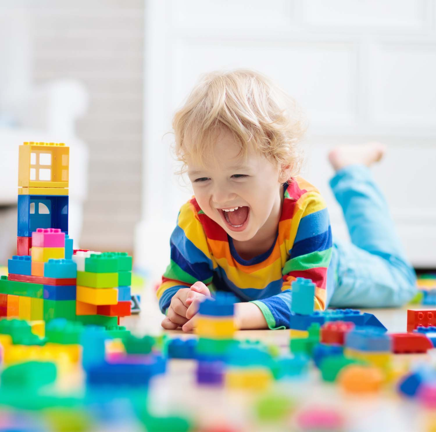 Photo of a Child Playing With Toy Blocks. Toys For Kids.