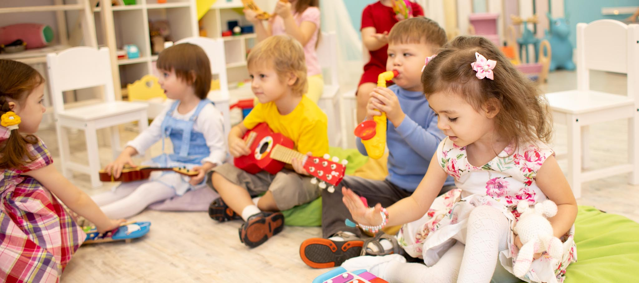 Photo of children Learning Musical Instruments